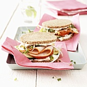 Small sliced turkey and cucumber sandwiches