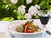 Grilled lamb cutlet with tomato and peppers