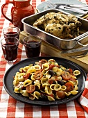 Orecchiette with cocktail tomatoes, chicken in roasting tin