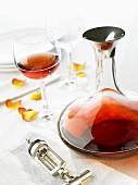 Red wine in glass and carafe, corkscrew