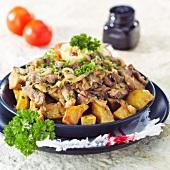 Brassoer Leckerei (Braised pork with fried potatoes)