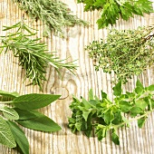 A selection of fresh herbs on wooden background