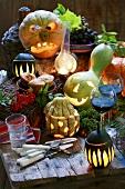 Autumnal arrangement with illuminated pumpkins & red wine