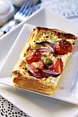 Soft cheese and tomatoes in puff pastry case
