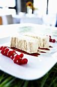 Ice cream dessert with redcurrant sauce