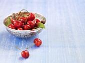 Fresh cherries in a silver dish