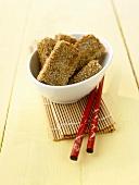 Sesame tofu in small white bowl, chopsticks
