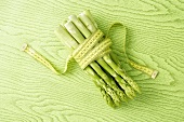 Green asparagus with a tape measure