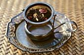 Dried tea leaves in tea strainer