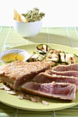 Seared tuna steak with flaked almonds and courgettes