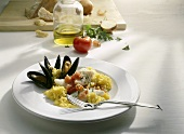 Saffron risotto with mussels and halibut