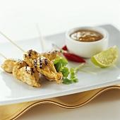 Chicken satay with coriander, chilli, peanut sauce & lime