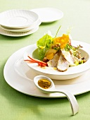 Roast chicken breast with salad and curry powder