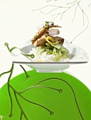 Roast saddle of rabbit on vegetables and rice