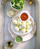 Saffron eggs with three sauces
