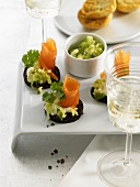 Marinated salmon with spring onions on sweet potato slices