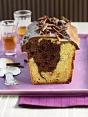 Marble cake with chocolate icing and chocolate curls