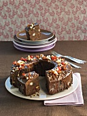 Ring-shaped whisky chocolate cake with macadamia nuts