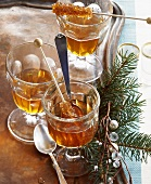 Jagertee (tea with rum) with sugar swizzle sticks