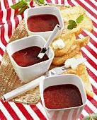 Three bowls of strawberry & kiwi fruit jam with toast