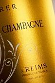 Detail of a Roederer Cristal Millennium champagne bottle