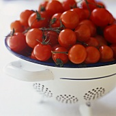 Cocktail tomatoes in a colander