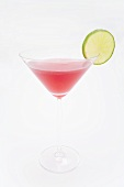 A Cosmopolitan cocktail with slice of lime