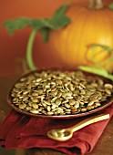 Pumpkin seeds, a pumpkin in background