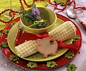 Place-setting with rosemary and lucky pig (for New Year)