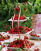 Fresh cherries on tiered stand on a garden table