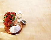 Strawberries, preserving sugar and preserving jars