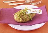 Place-card on potato