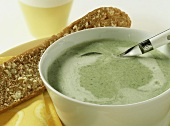 Broccoli and cheese soup with garlic baguette