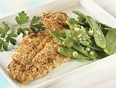Breaded plaice fillet with mangetout
