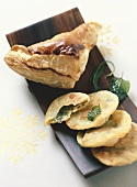 Spinach pie with puff pastry and noodle cakes with herbs