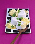 Coconut pudding with pineapple and mint
