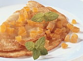 Pancake with bottled apricots