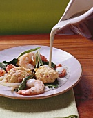 Shellfish dumplings with tarragon sauce and chard