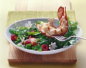 Half grilled lobster with wild herb salad