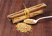 Granulated cane sugar and cinnamon sticks