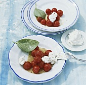 Stewed cherry tomatoes with fresh goat's cheese