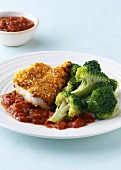 Cod fillet with sesame and carrot coating and broccoli