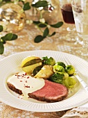 Roast beef with potatoes, Brussels sprouts and sauce (Christmas)