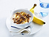 Yoghurt with banana, nuts and chocolate curls