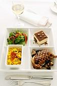 Meal: chicken, rice, salad and tiramisu