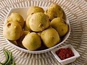 Batata vada (Potato balls in batter, India)
