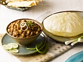 Chole bhature (chick-peas in spicy sauce, India) with poppadom