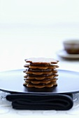 Tower of ginger biscuits with chocolate cream