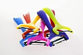 Several coloured vegetable peelers