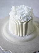 Small white cake with ruffle decoration
